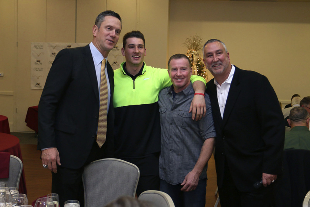 Former Patriots quarterback Drew Bledsoe, left, at a wine-tasting at Four Oaks Country Club in Dracut last December with, from left, Michael Kuenzler Jr., of Dracut, Micky Ward of Lowell, and Michael Kuenzler Sr., owner of Four Oaks. SUN FILE PHOTO